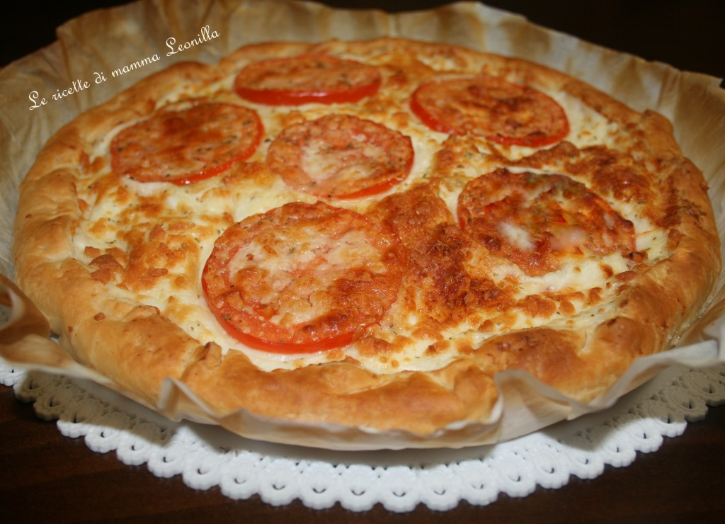 Pizza di pasta sfoglia al formaggio e pomodoro ricetta for Torte salate con pasta sfoglia
