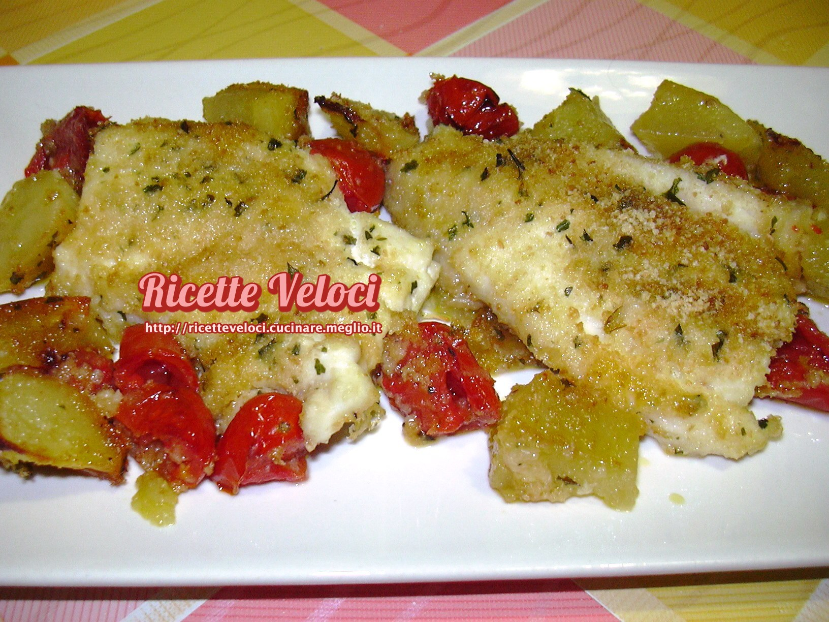 Palombo al forno con patate e pomodori datterini