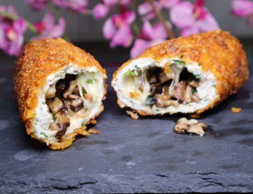 Involtini di pollo croccanti senza glutine ripieni di funghi e mozzarella.