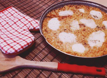 Torta di riso al ragù di salsiccia e mozzarella