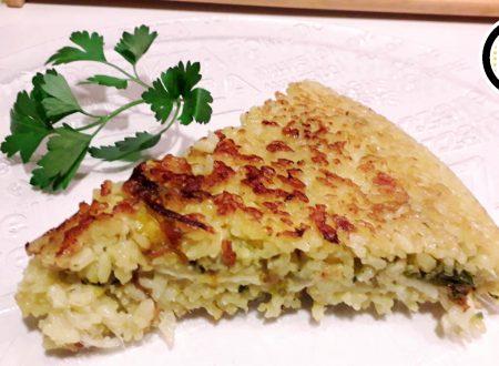 Tortino di riso allo zafferano con fiori di zucca