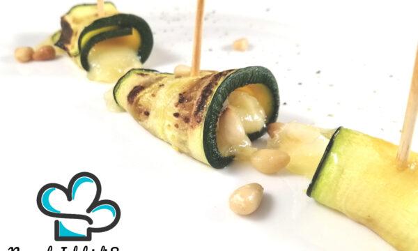 Involtini di zucchine ed emmental con pinoli tostati