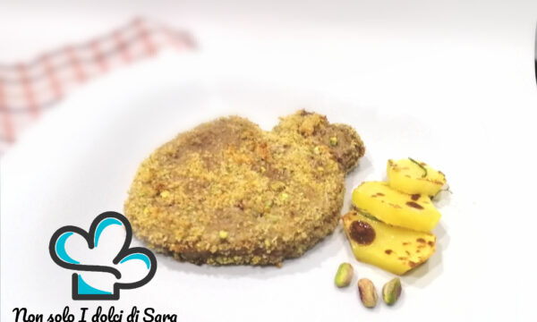 Medaglioni di bovino con panure di pistacchi e patate grigliate