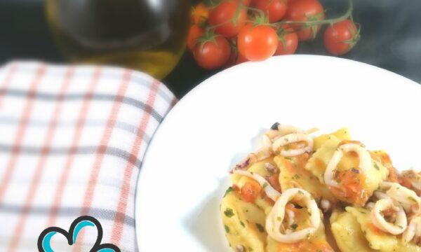 Ravioli di sedano rapa con calamari e pomodorini