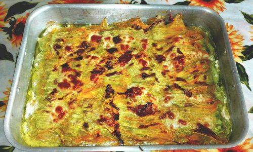 Zucchine e fiori di zucca al forno