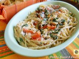 Spaghetti alla chitarra con rucola ricotta e pomodorini