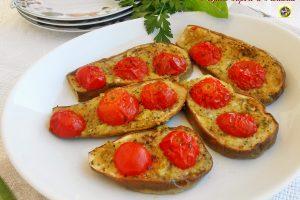 Melanzane gratinate con farcia al parmigiano e pomodorini