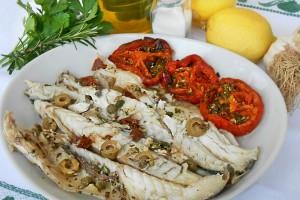 Branzini ai capperi e olive al forno