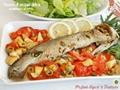 Pesce di acqua dolce aromatico al forno