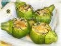 Zucchine tonde ripiene con agretti uova sode e mozzarella
