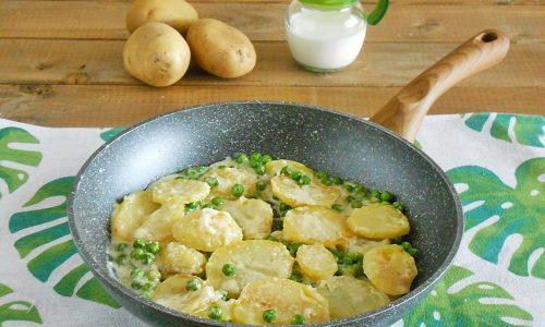 Patate cotte nel latte con piselli e formaggio