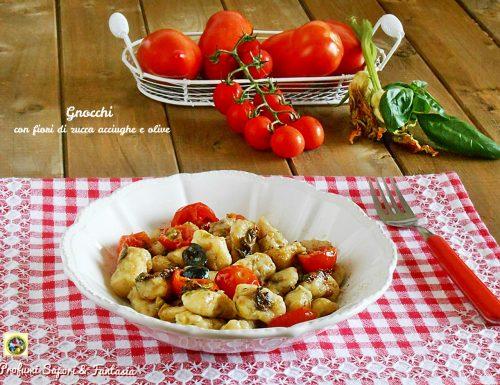 Gnocchi con fiori di zucca acciughe e olive