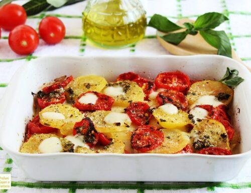 Patate pomodori e provola al forno