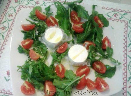Rotolini di formaggio di capra  con rucola e pomodorini