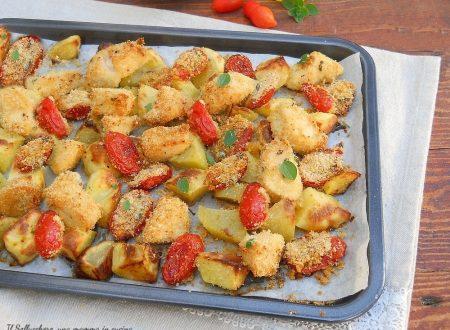 Bocconcini di pollo con patate e pomodorini gratinati