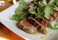 Tagliata di manzo con rucola, grana e olio al tartufo nero