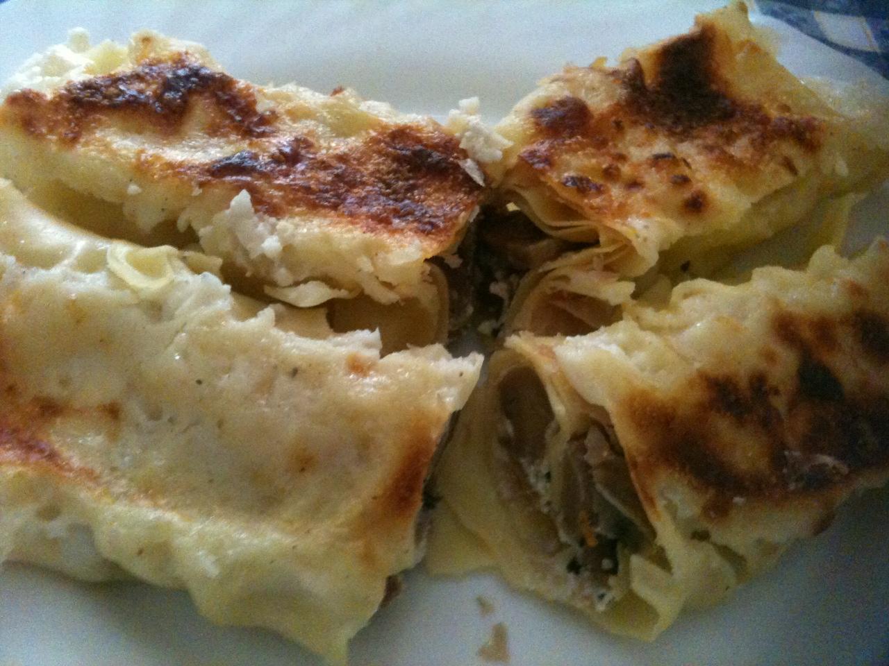 Cannelloni ripieni di prosciutto cotto, ricotta, funghi e grana