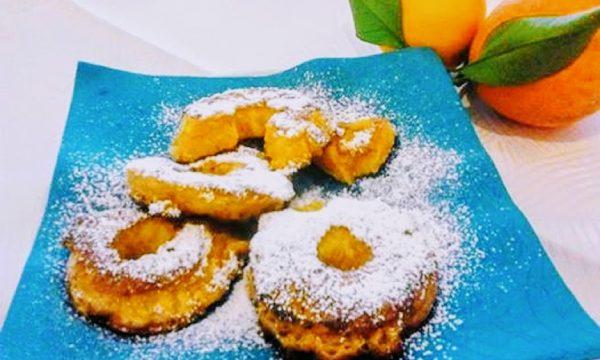 Ciambelle fritte di arancia