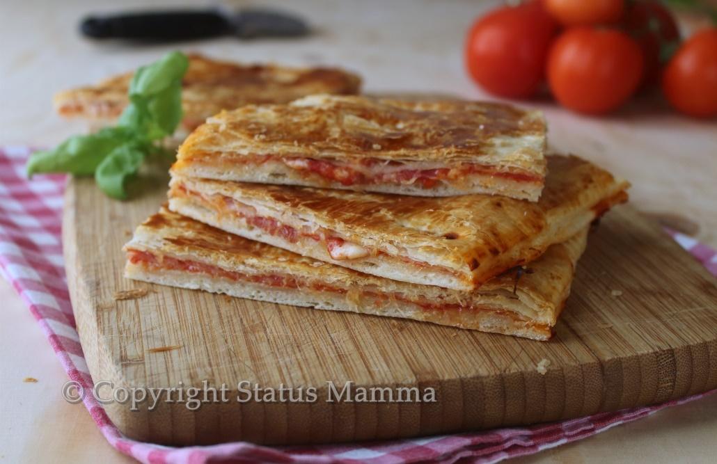 ricetta cucinare facile veloce pizza con pasta sfoglia ripiena facile veloce economica bambini statusmamma giallozafferano foto