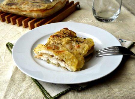 Teglia di patate e pesce gratinati al forno