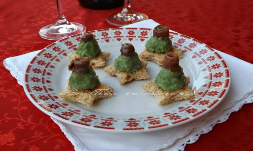 Tartine con crema di broccoli e acciughe