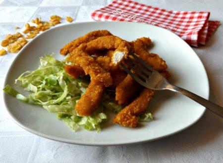 Bastoncini di petto di pollo ai corn flakes