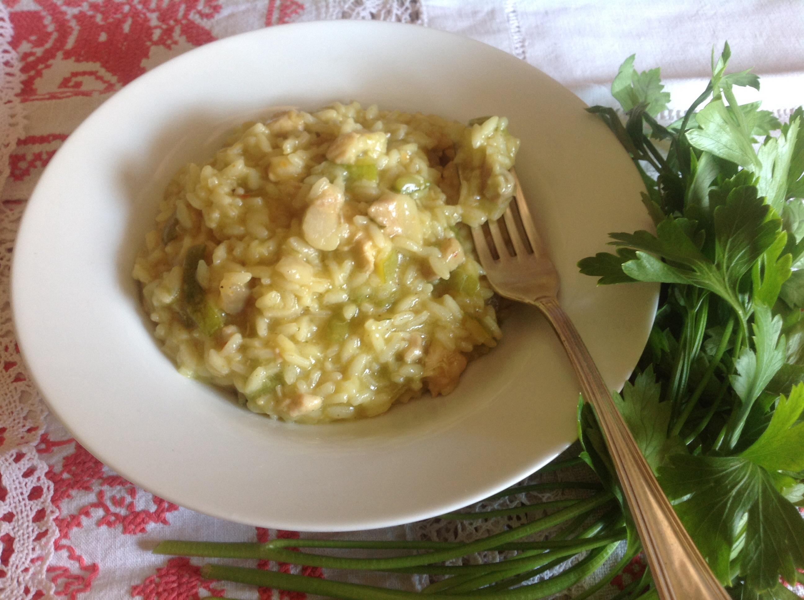Risotto al pollo con zucchine e pancetta