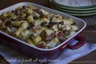 ricetta gustosa pasta al forno funghi e prosciutto crudo ricetta primo facile gustoso con porcini besciamella e provola