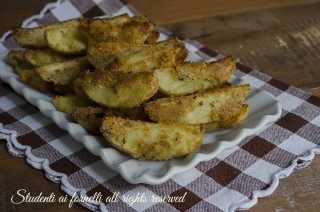ricetta patate croccanti e saporite al forno con parmigiano e pangrattato ricetta contorno facile e veloce
