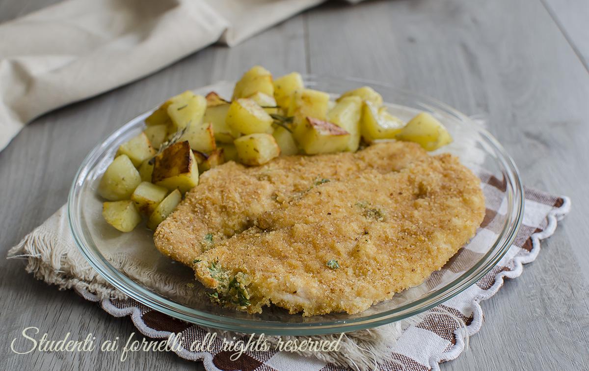 cotolette di pollo al forno ricetta con impanatura al parmigiano senza frittura ricetta secondo