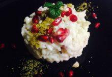 Risotto alla melagrana e polvere di pistacchio mantecato con burro di mandorle