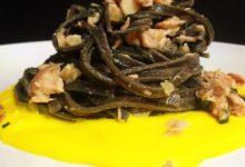Tagliatelle al nero di seppia con tonno su crema di zafferano