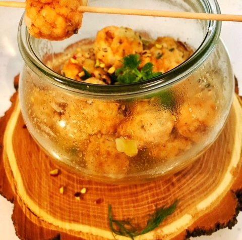 Polpettine di salmone e pistacchi cotte in vasocottura