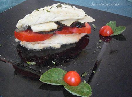 Parmigiana di melanzane e pesce