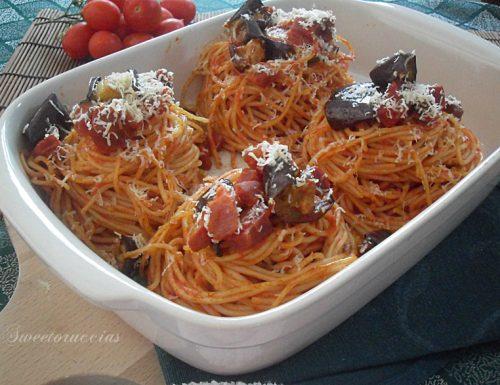 Spaghetti gratinati con speck e melanzane