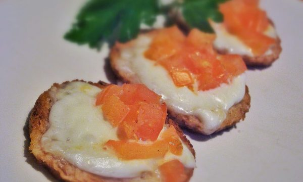 Whole wheat bruschetta with tomato and fresh mozzarella