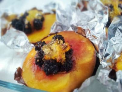 Baked berry-filled peaches