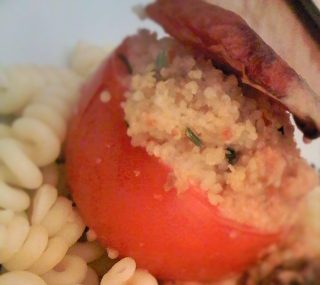 Baked tomatoes with couscous and pine nuts