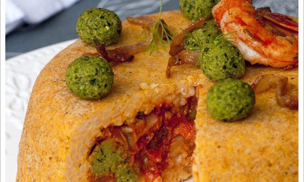 Sartù di riso con Gamberoni, Guanciale e polpettine di Zucchine, con besciamella al Pecorino