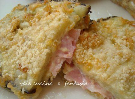 Melanzane fritte dorate ripiene di prosciutto e formaggio