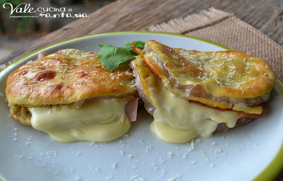 Melanzane pastellate al forno con mortadella e formaggio