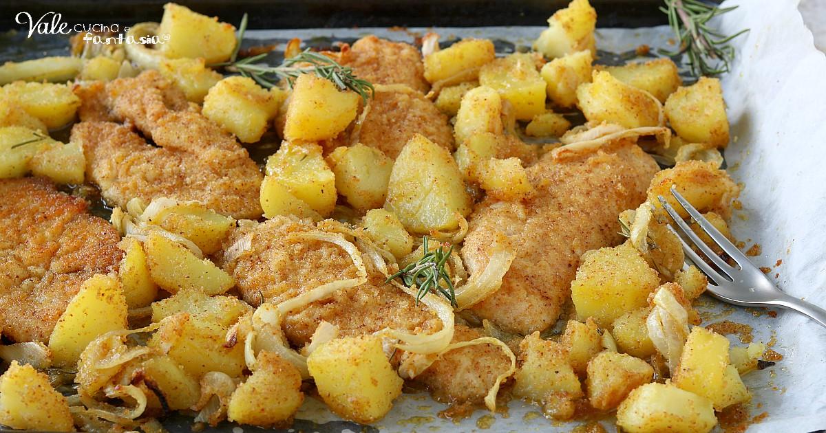 PETTI DI POLLO AL FORNO con patate e cipolle