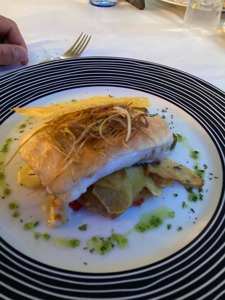 Baccalà con puré di aglio tostato