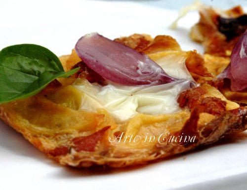 Patate al forno con prosciutto e cipolle