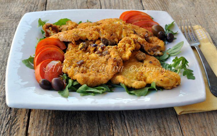 Cotolette di pollo con formaggio e olive