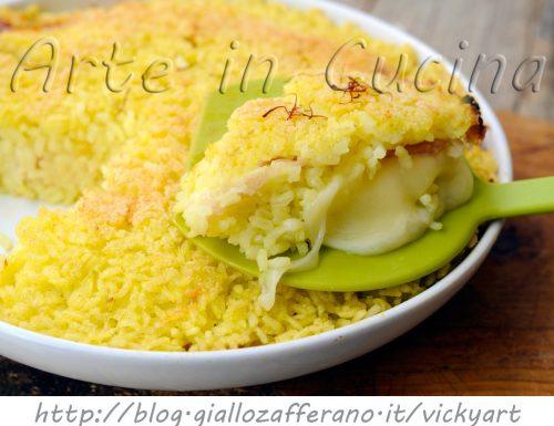 Tortino di riso giallo gratinato con asiago e prosciutto