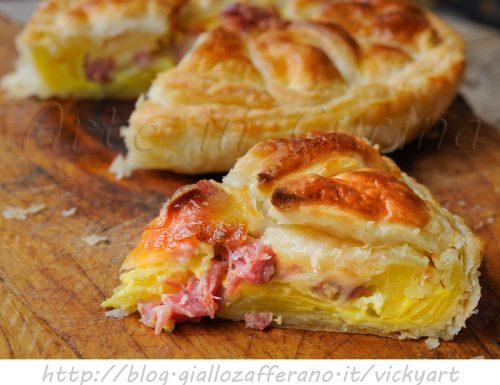 Torta sfogliata salata ai formaggi patate e salumi