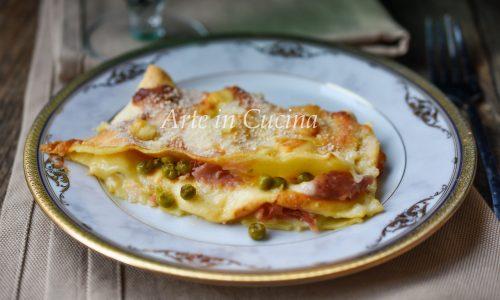Lasagne con piselli e prosciutto al forno