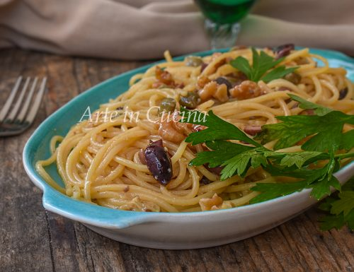 Spaghetti risottati con noci e olive