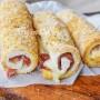 Cannoli di pane con speck al forno